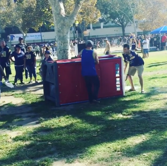 Seahawks Fan Gets Porta Potty Tipped On Him By Rams Fan
