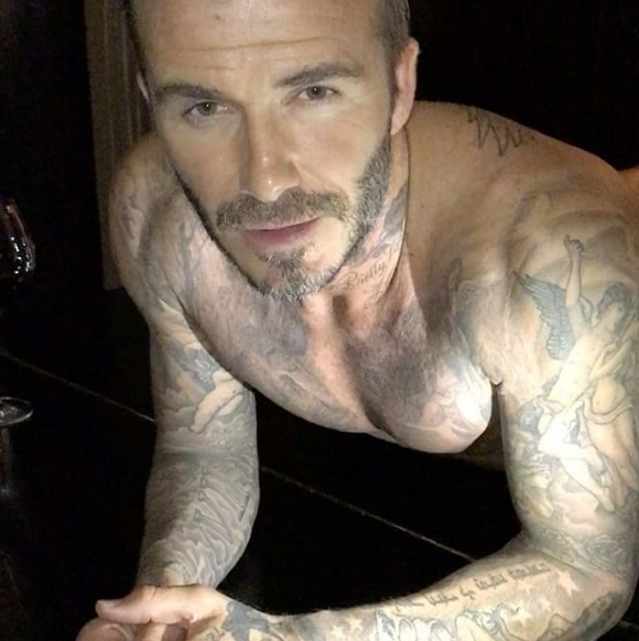 David Beckham doing Push Ups on a grand piano with wine!