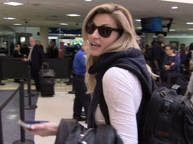 Erin Andrews talks football while departing LAX