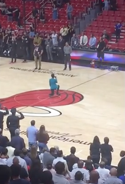 National Anthem Singer Takes A Knee During Anthem