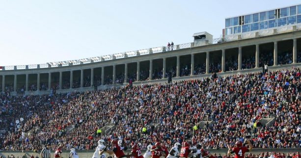 Yale fans get naked and dance on the wall of Harvard Stadium