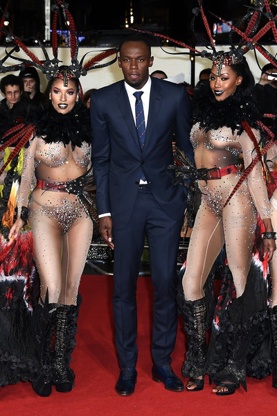 Usain Bolt Surrounds Himself With Beauties at Premiere