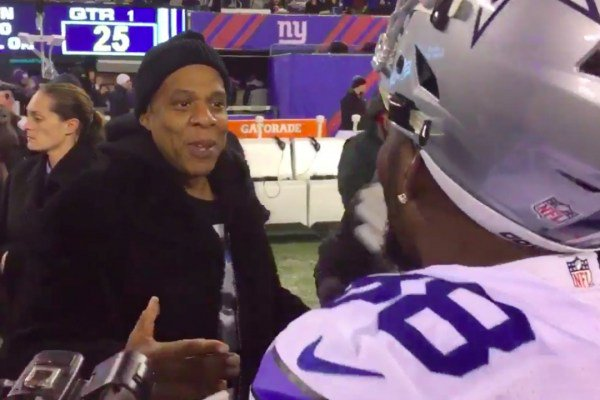 Jay Z Daps up Dez Bryant and Jerry Jones