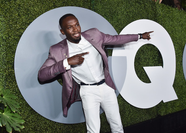 Usain Bolt Strikes The Pose At GQ Man Of The Year Party