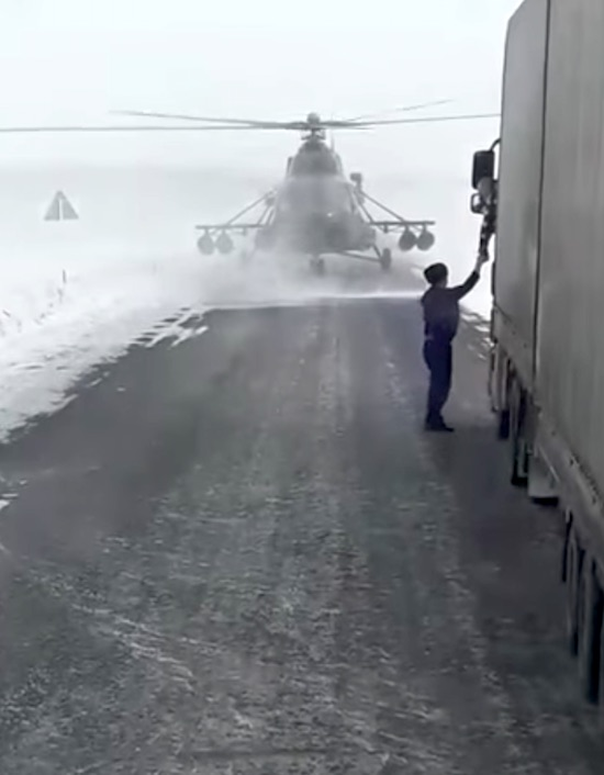 Military Helicopter Lands On Snowy Road To Ask For Directions