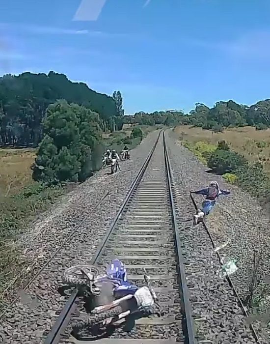 Dirt Bike Gets Caught On A Train Track And Dude Barely Escapes