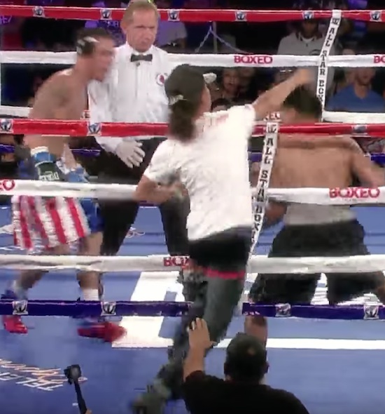 Crazy Fan Climbs Ring And Throws A Punch At Boxer