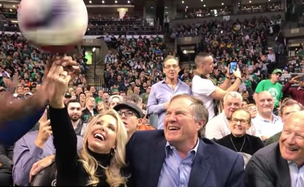 Bill Belichick and Girlfriend Laugh with Harlem Globetrotters