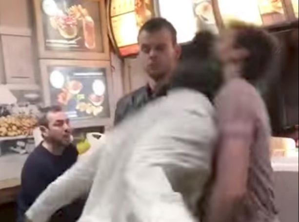 Drunk Guy Throws Vicious Headbutt During Barber Shop Fight