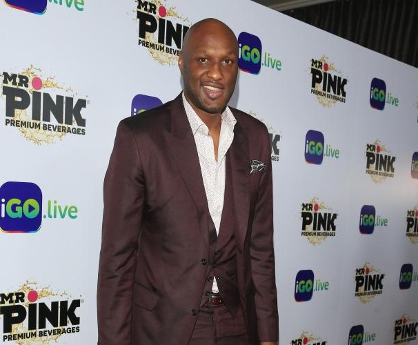 Lamar Odom Cozies up with the Evil Empire's # 1 Enemy