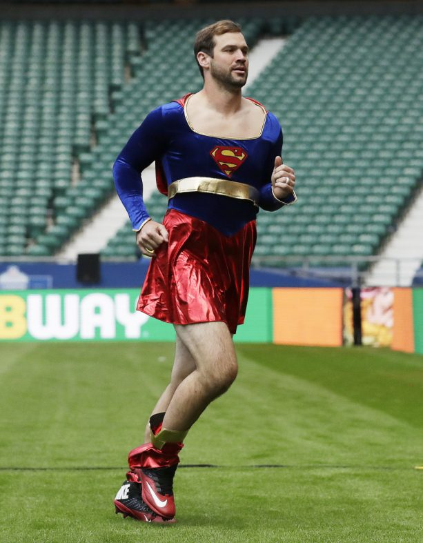 Here's Why a Cardinals QB was Forced to Warm up in a Supergirl Costume