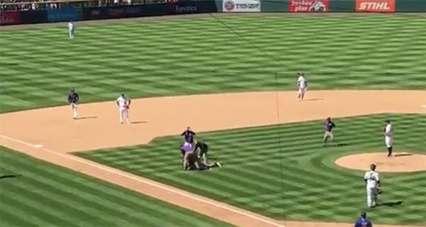 Fan Rushes Field During Cubs-Rockies Game & Gets Owned By Security Guards