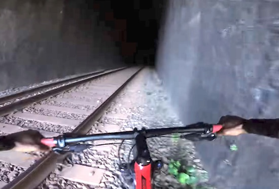 Mountain Biker Narrowly Avoids Death From Oncoming Train