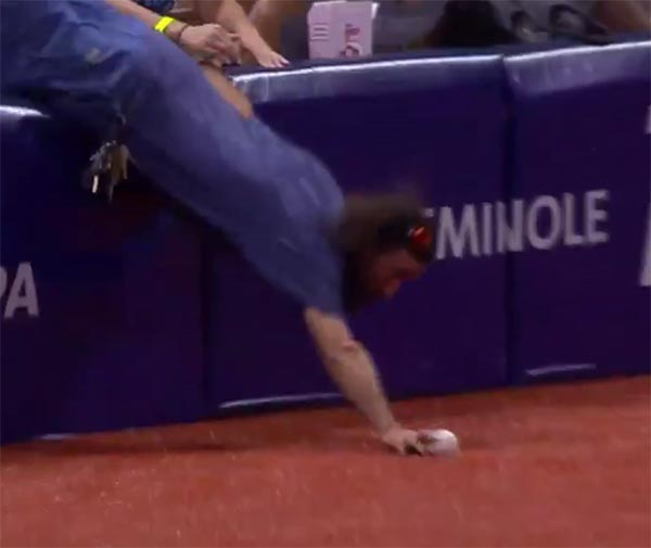 Rays Fan Faceplants After Leaping Out Of The Stands For A Foul Ball (VIDEO)