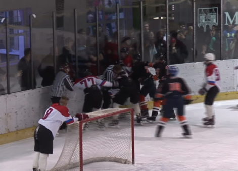 Youth Hockey Game Ends With A Huge Brawl That Includes A Referee Throwing Punches