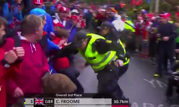 Fan Gets Trucked by Two Security Guards in the Middle of a Cycling Race