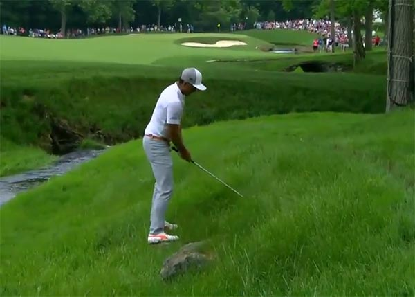 Watch Rickie Fowler Hit A Golf Shot While Balancing On A Pair Of Rocks