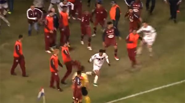 Soccer Player Runs For His Life To Avoid Being Jumped By Opposing Team (VIDEO)