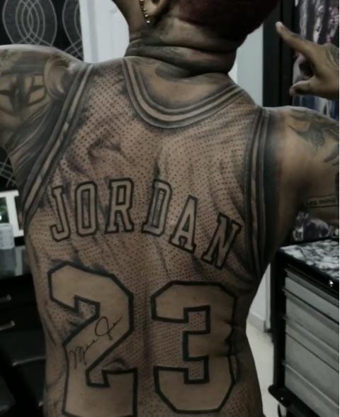Fan Gets A Huge Tattoo Of Michael Jordan's Jersey On His Back (VIDEO)